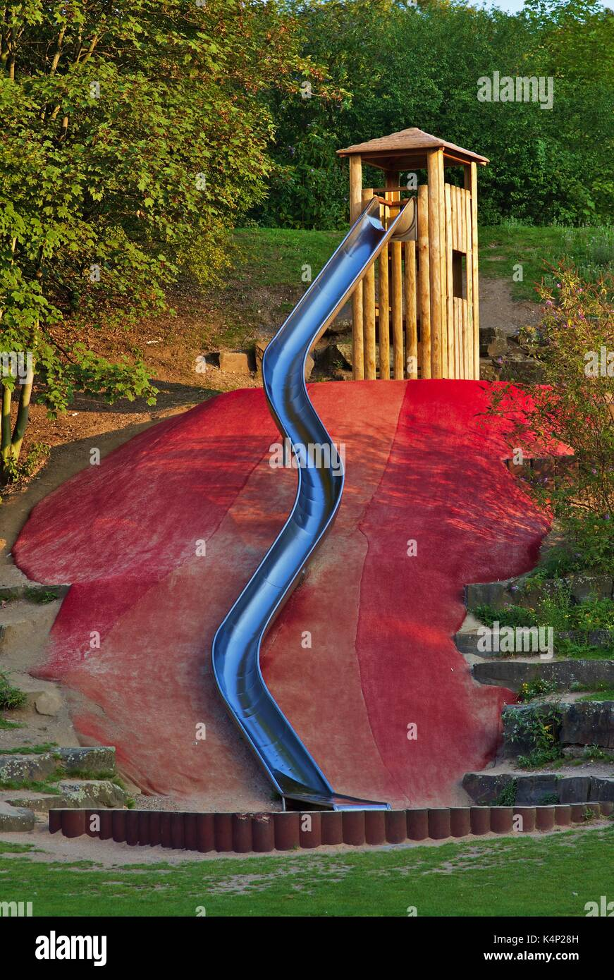 large-metal-slide-on-playground-wooden-tower-K4P28H.jpg
