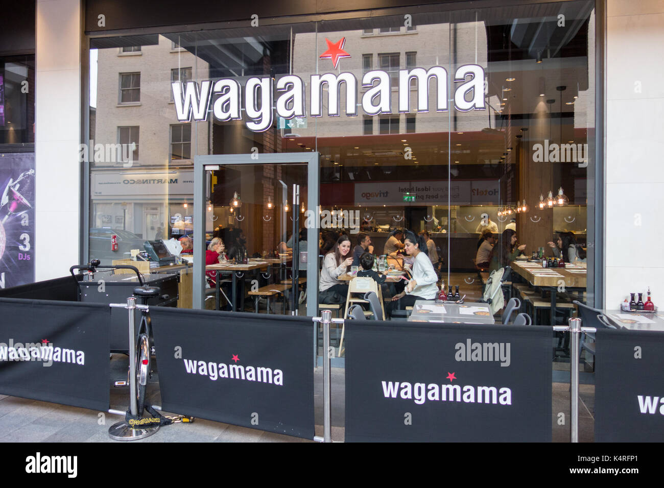 Wagamama - an Asian-inspired Japanese chain restaurant in Ealing, west London, U.K. Stock Photo