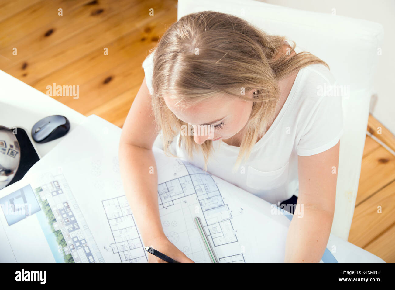 Top view at architect's desk where architect is working - Stock Image