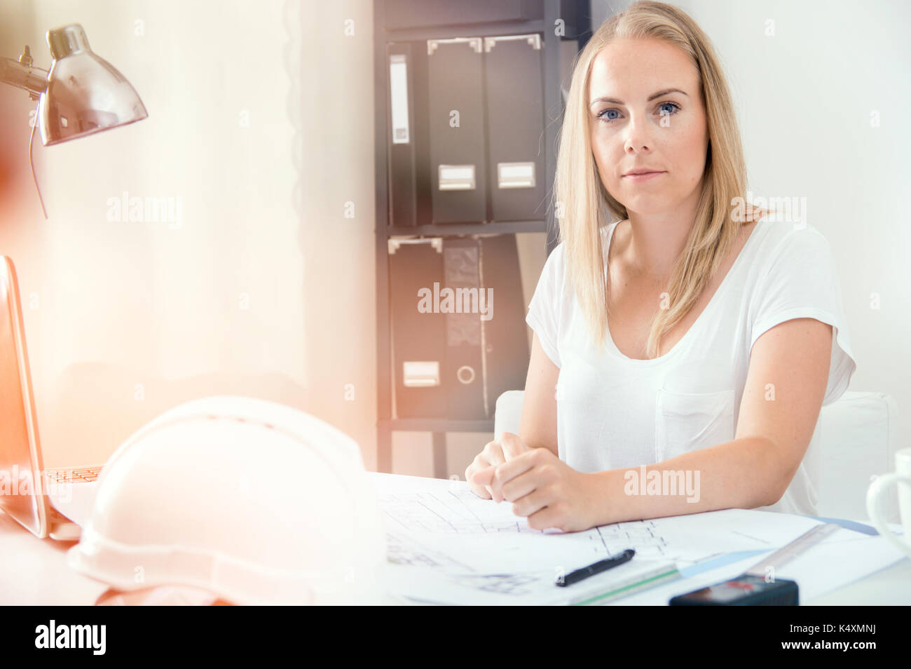 Architect is working with her new project at home office - Stock Image