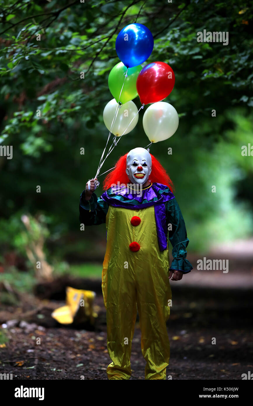 POSED BY MODEL A person wearing a clown costume in Liverpool as reviews for the film adaptation of Stephen Kingu0027s It are in with critics predicting the ... & POSED BY MODEL A person wearing a clown costume in Liverpool as ...