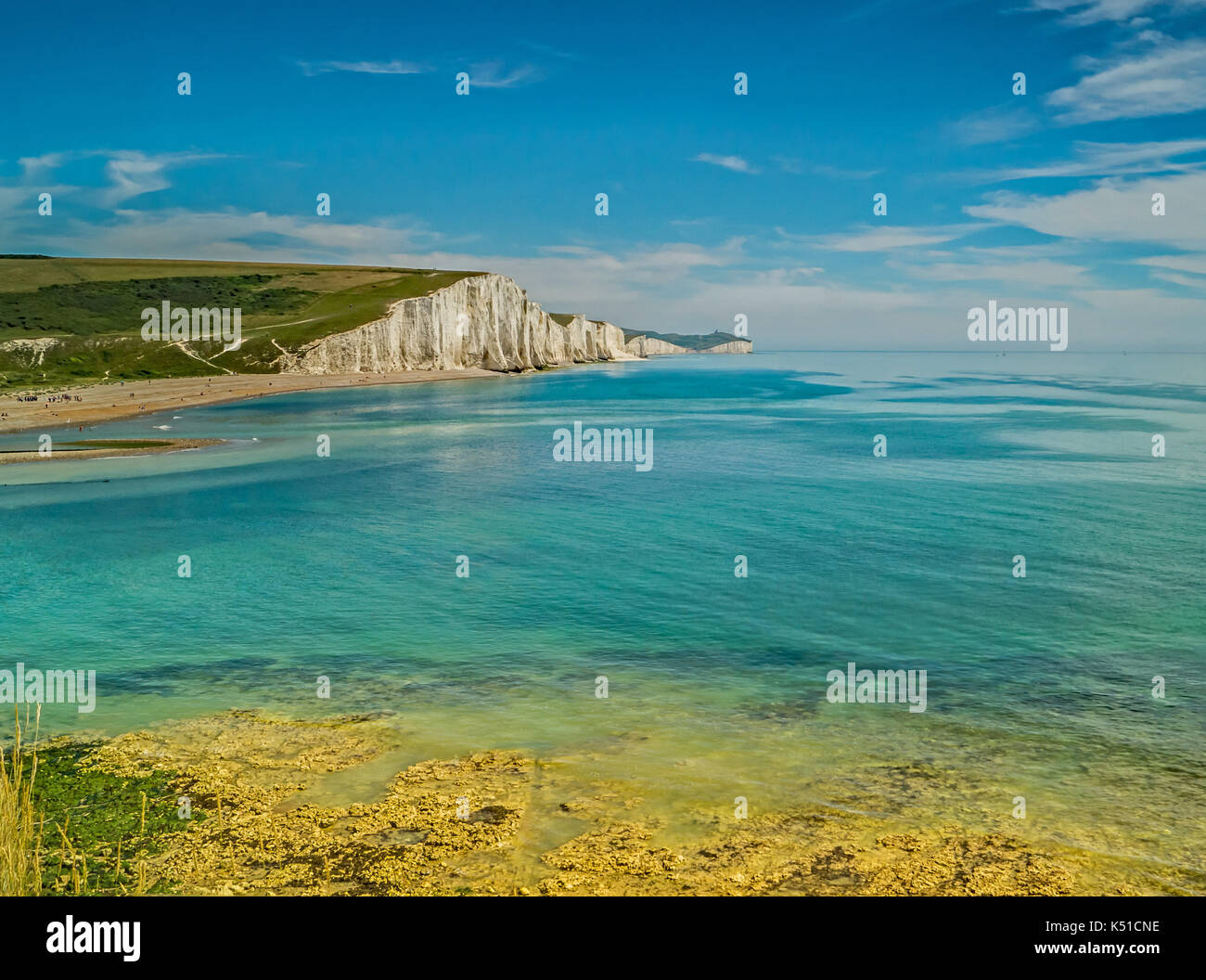 The Seven Sisters Cliffs,Sussex England,From the shore-Across the Bay. Stock Photo