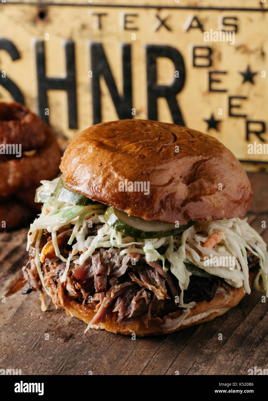 BBQ Pulled Pork Sandwich with bleu cheese slaw and dill pickles, Texas Style - Stock Image