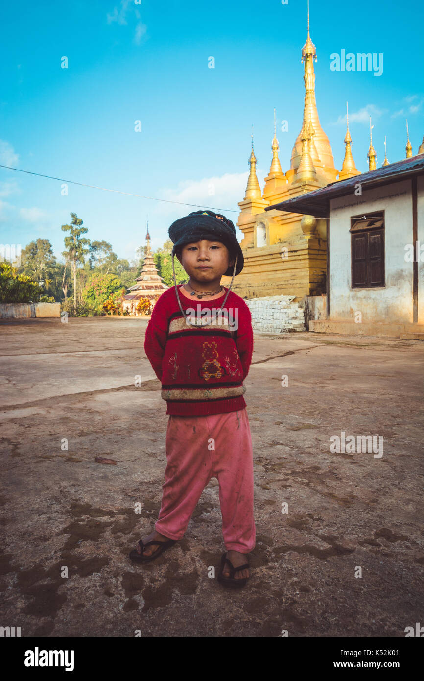 Shan State, Myanmar Dec. 26, 2013. A young boy I met, smiles and poses for the camera outside the Buddhist Montessori - Stock Image