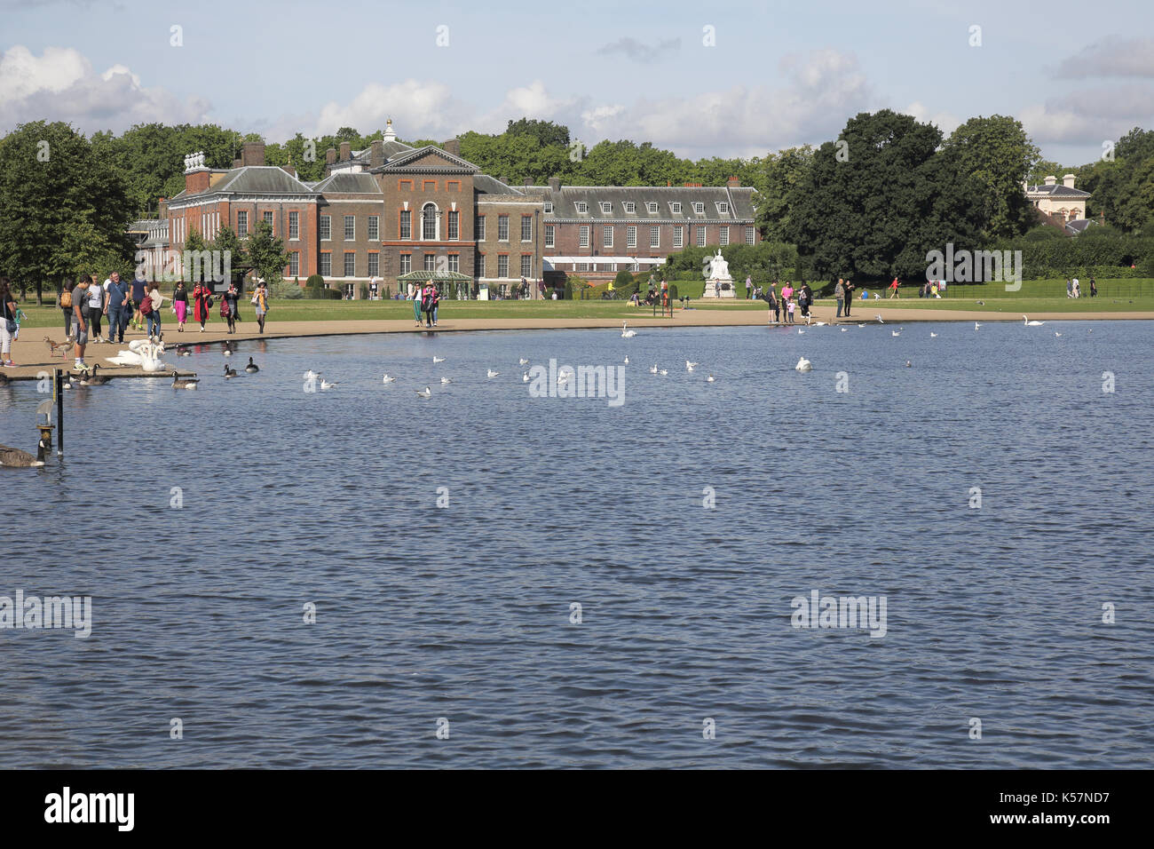 the round pond in hyde park with kensington palace in the distance london Stock Photo