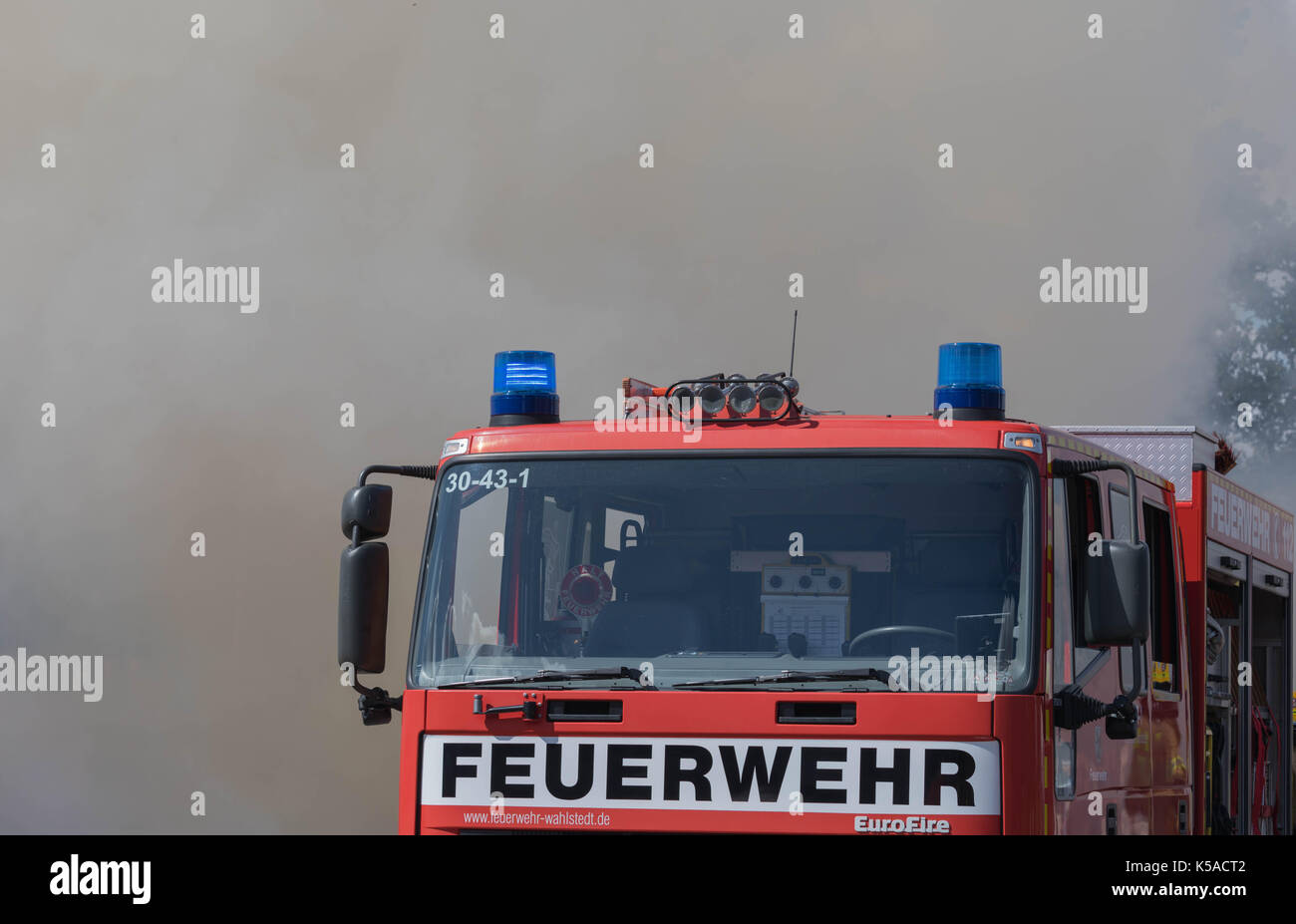 Bad Segeberg, Germany, September 03, 2017, Fire Truck in the middle of the Smoke during a fire demonstration - Stock Image