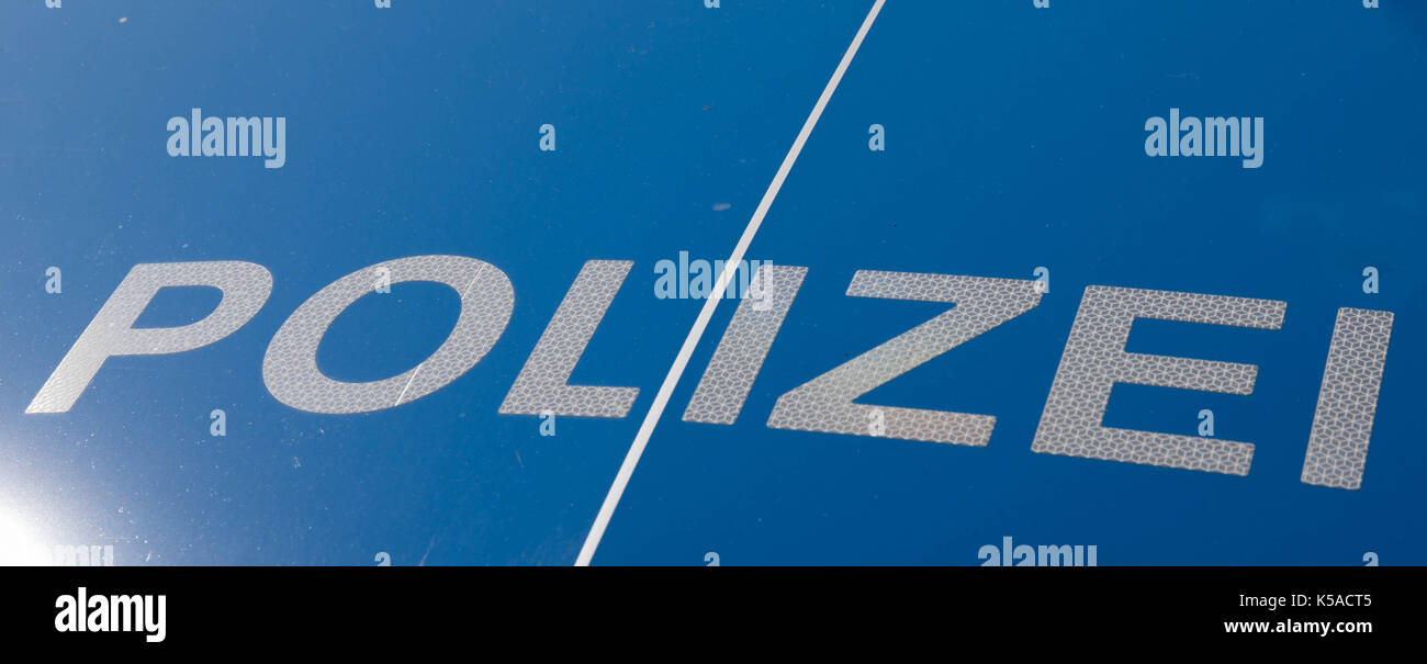 German police sign on a patrol car - Polizei - Stock Image