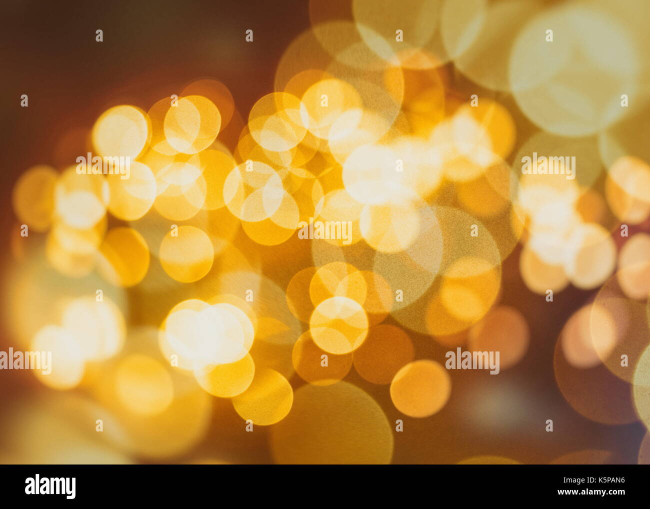 Festive background with natural bokeh and bright golden lights. Vintage Magic background with colorful bokeh. Spring - Stock Image