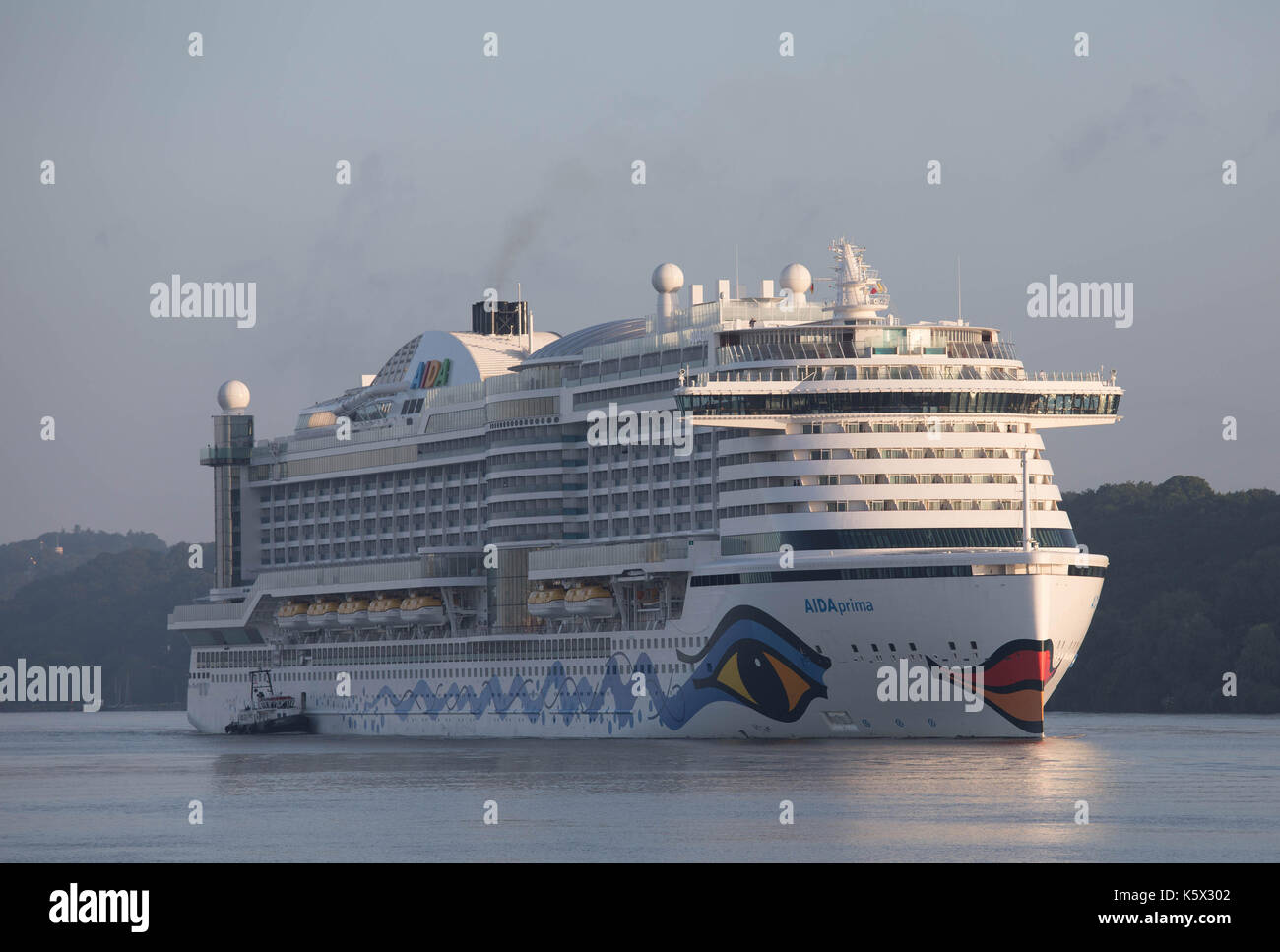 Hamburg, Germany, June 10, 2017 - Crusising Ship Aida Prima is entering the Port of Hamburg in the early daylight - Stock Image