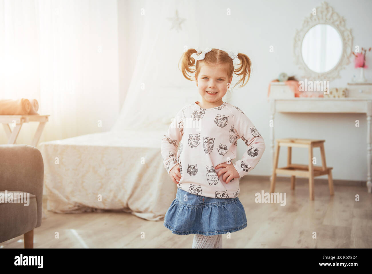 happy face funny baby girl. In a bright room - Stock Image