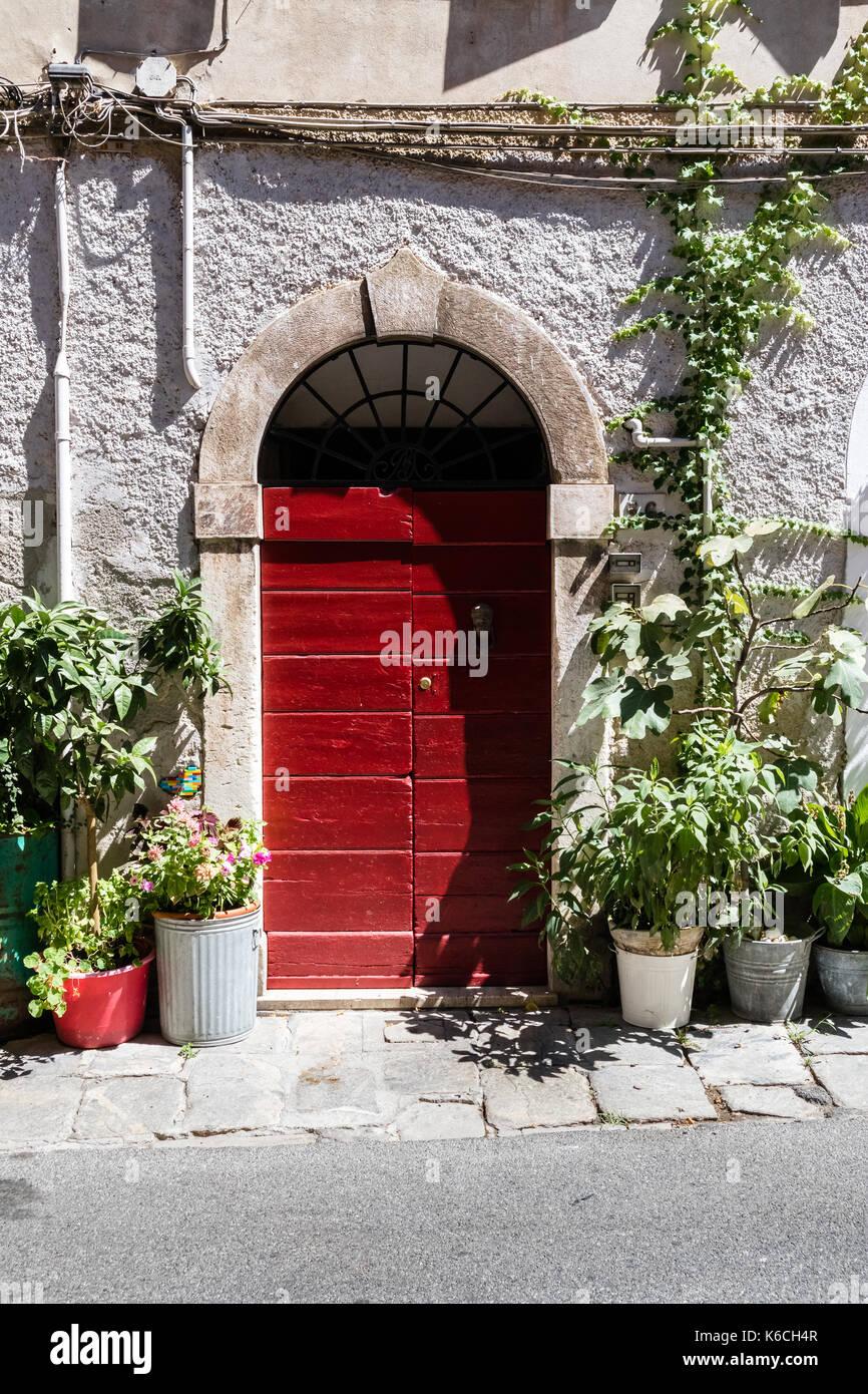 wooden door in an italian village - Stock Image