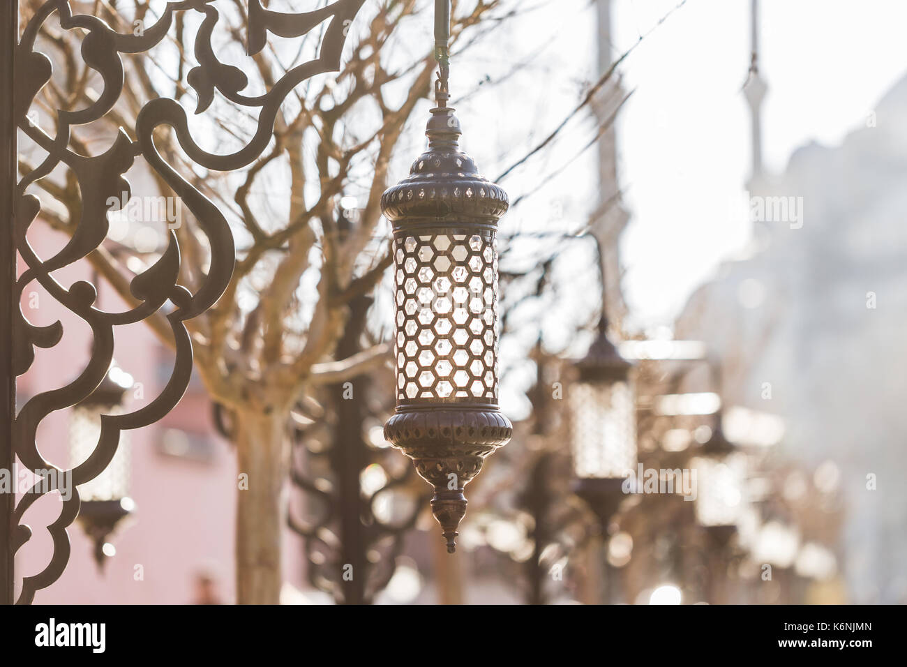 Many beautiful old vintage metal lantern on a square near the Blue Mosque in Istanbul. Forging metal poles. - Stock Image