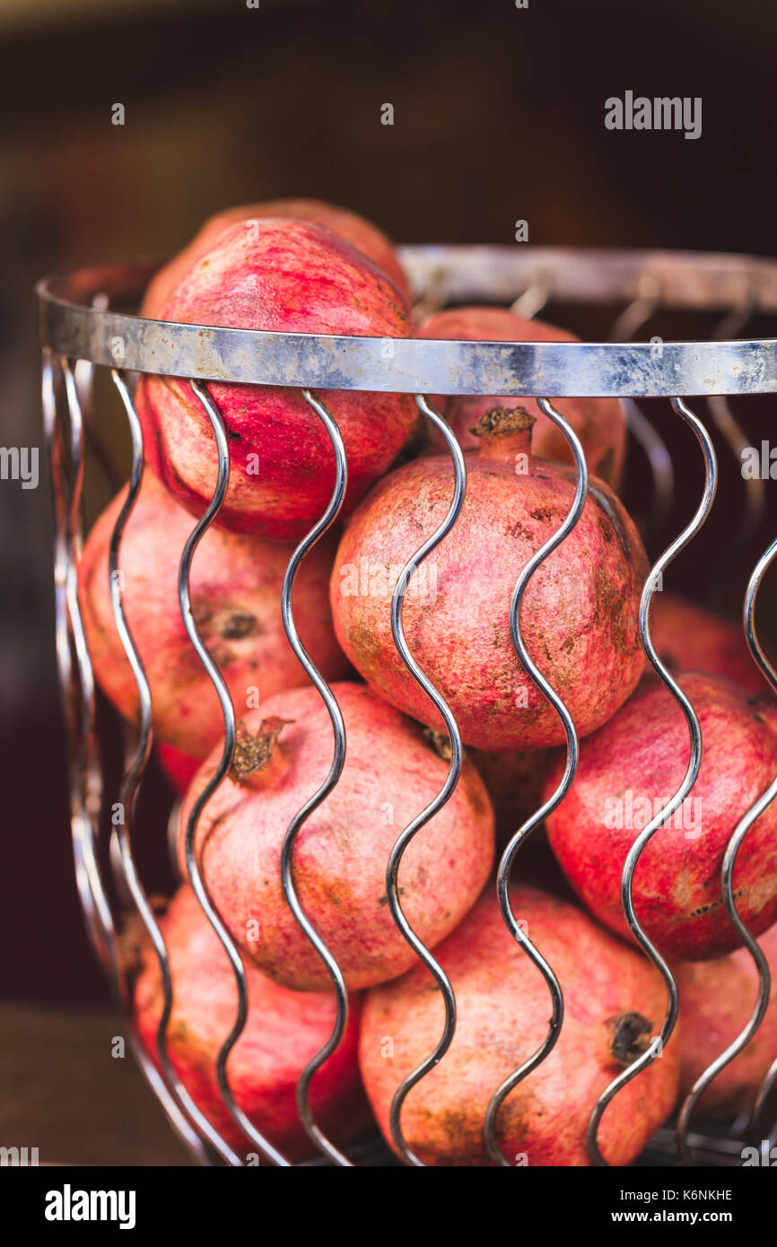 Fresh pomegranates in a basket in outdoor cafe in Istanbul - Stock Image