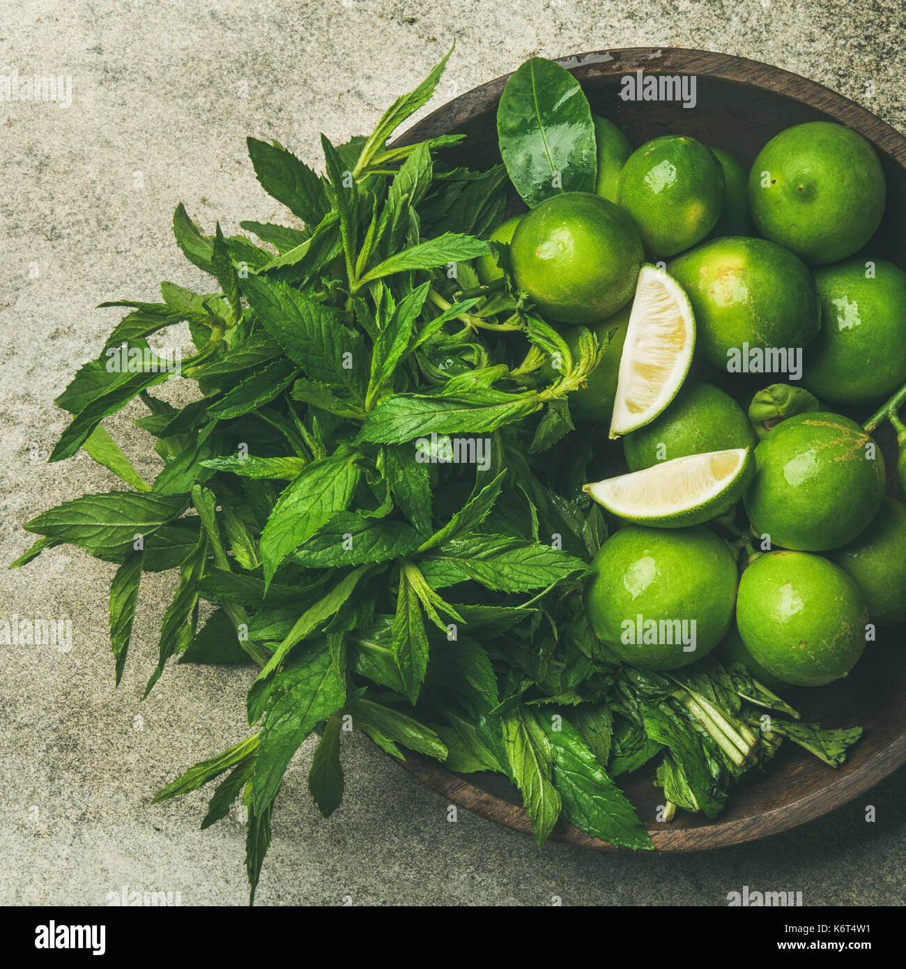Flatlay of fresh limes and mint, top view, square crop - Stock Image