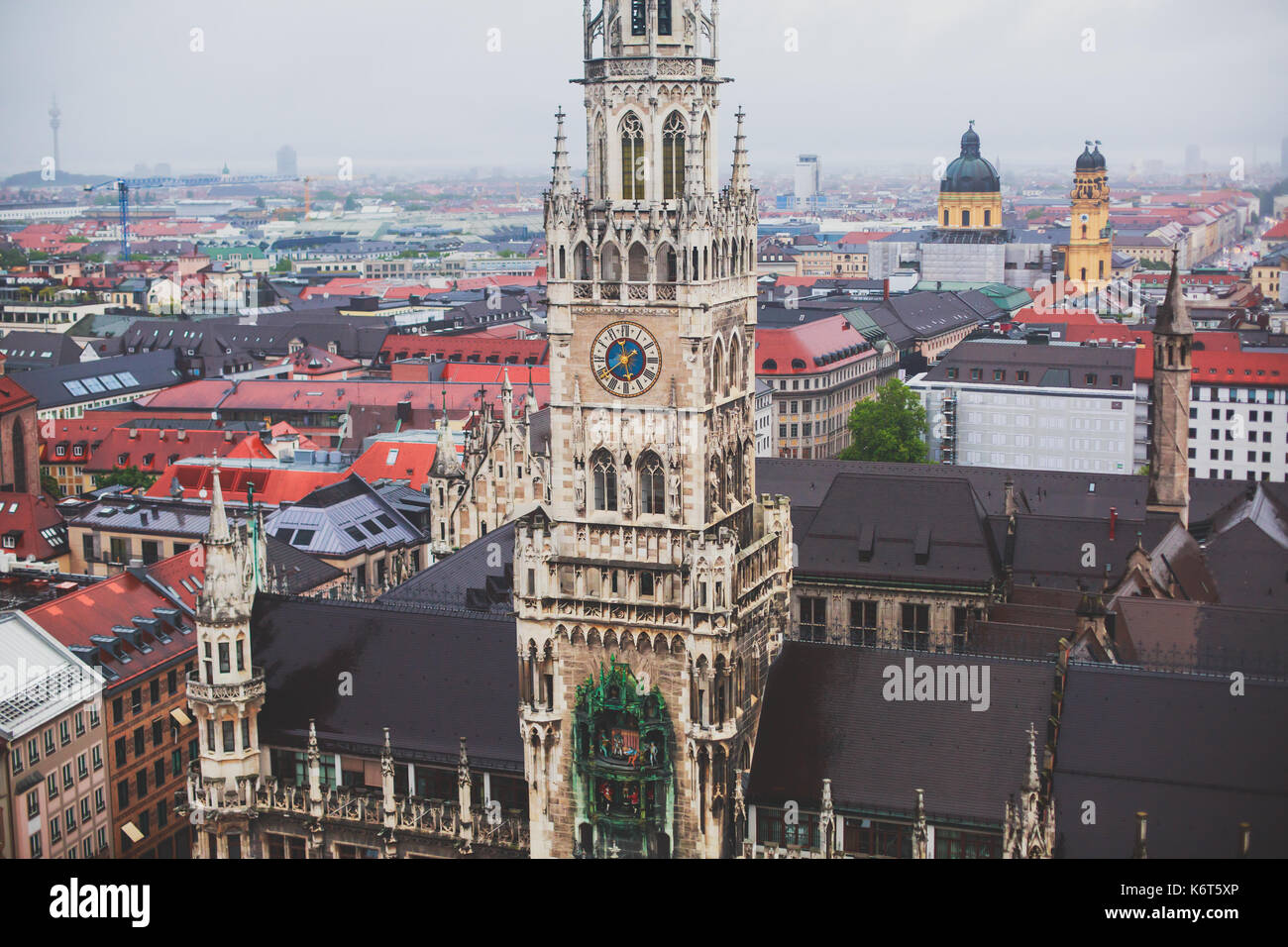 Beautiful super wide-angle sunny aerial view of Munich, Bayern, Bavaria, Germany with skyline and scenery beyond - Stock Image