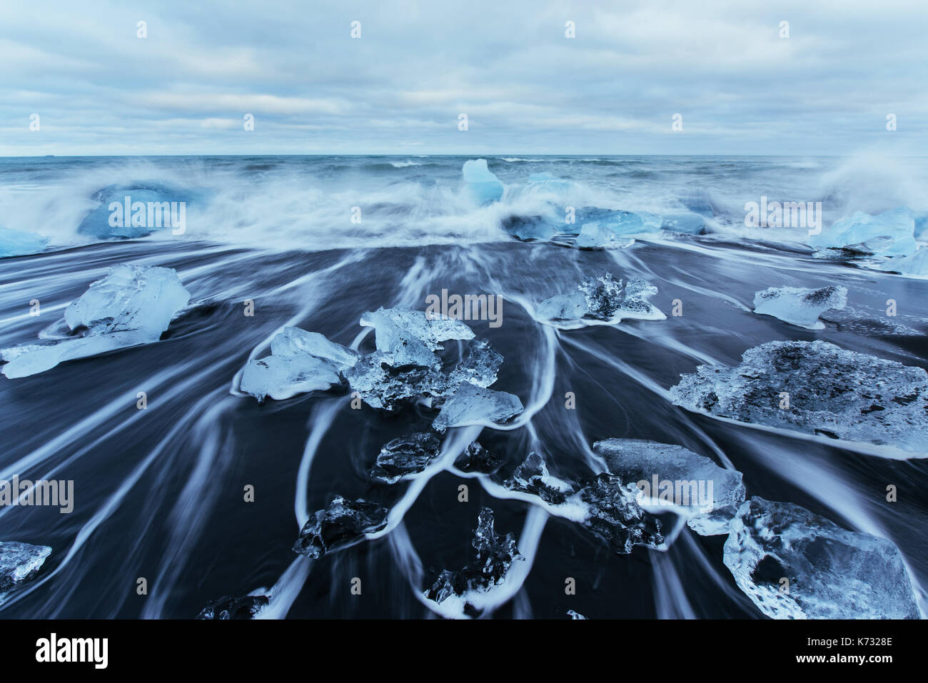 Jokulsarlon glacier lagoon, fantastic sunset on the black beach, Iceland. - Stock Image
