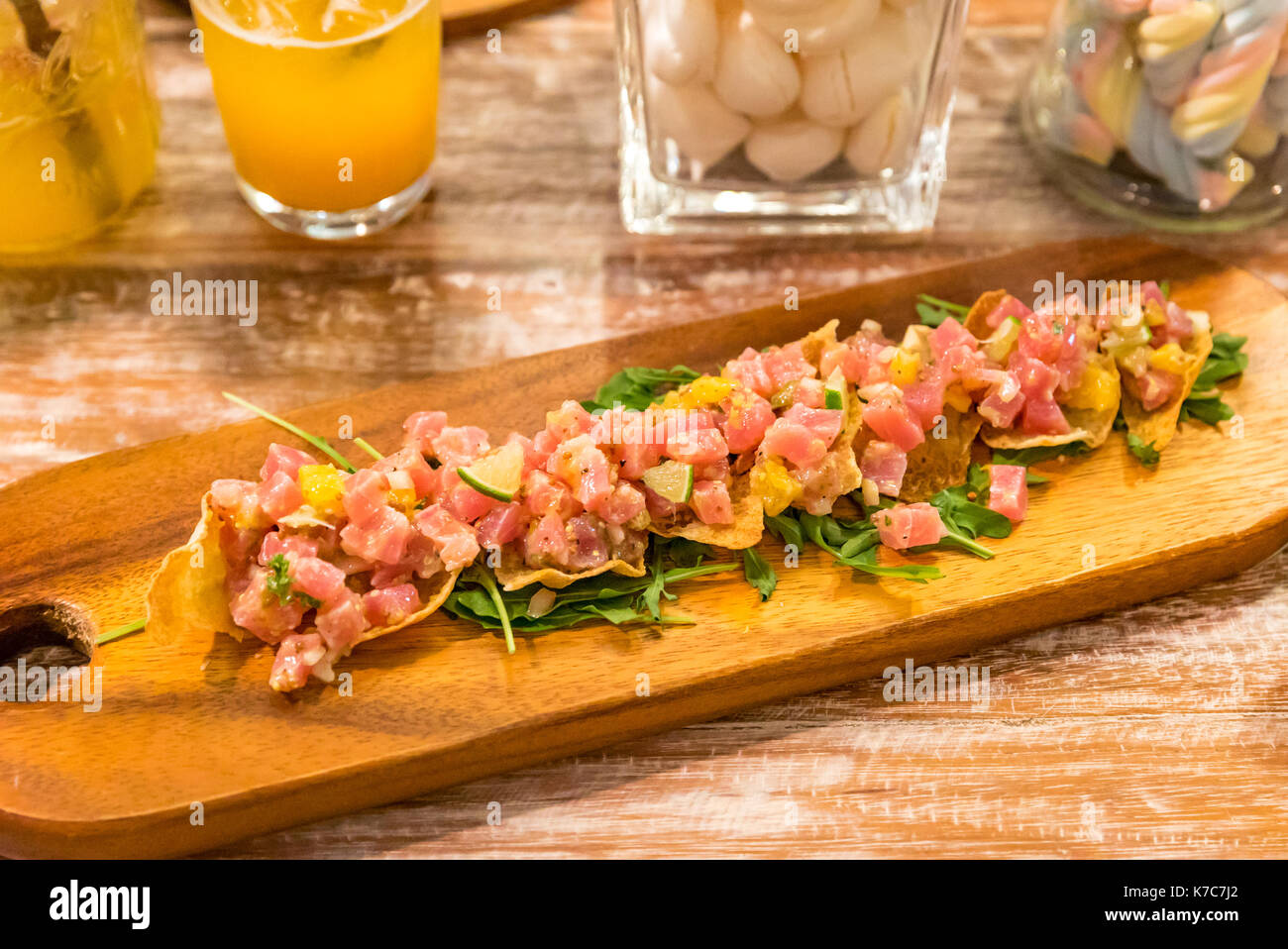 tuna tatare seafood fresh appetizer cuisine served with chip - Stock Image