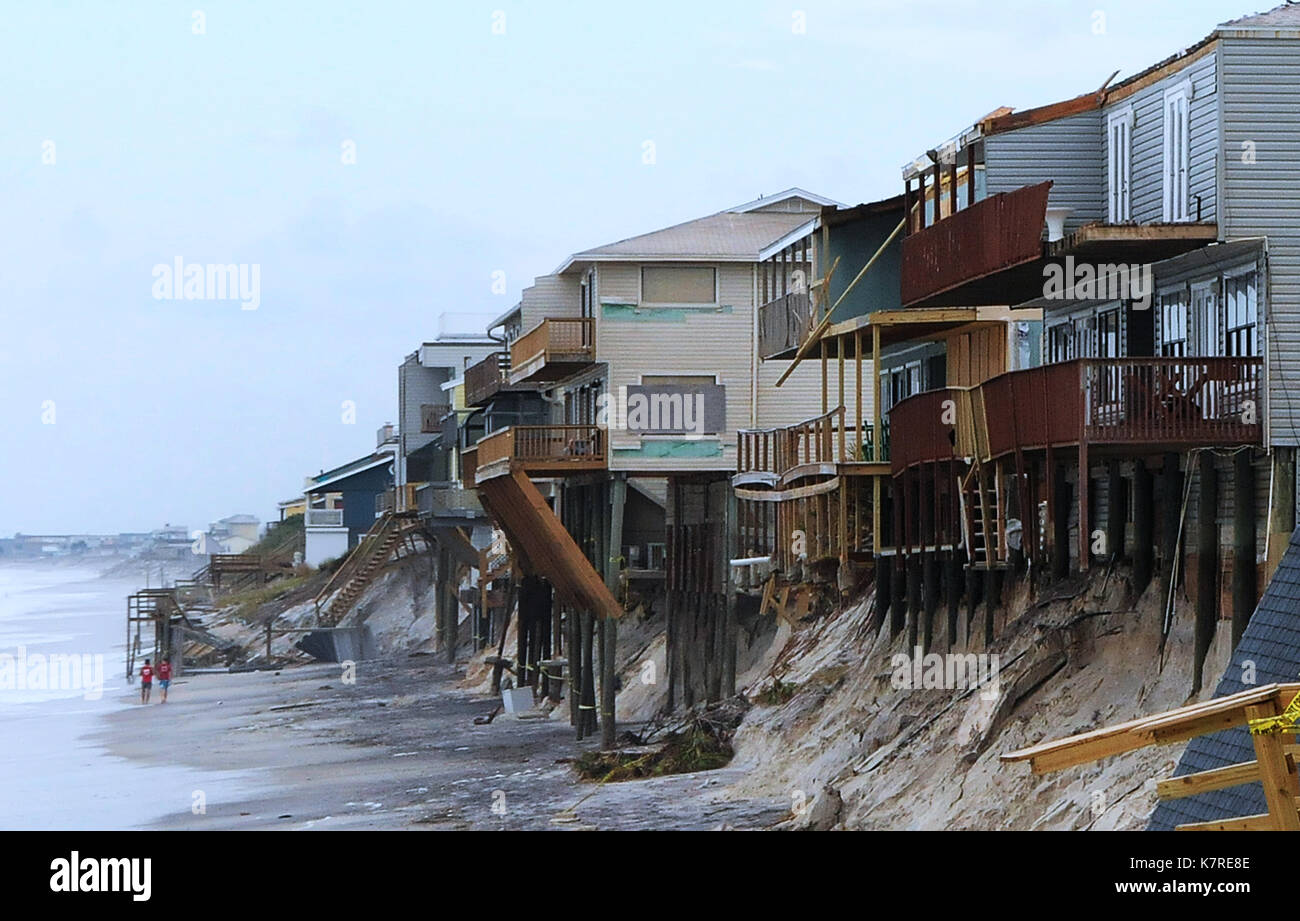 September 16, 2017- South Ponte Vedra Beach, Florida, United States - People walk the beach past beachfront homes - Stock Image