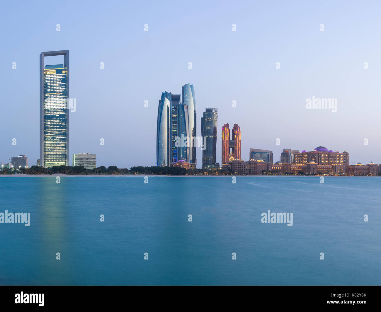 Etihad Towers and Emirates Palace hotel viewed from the Breakwater, Abu Dhabi, United Arab Emirates, Middle East - Stock Image
