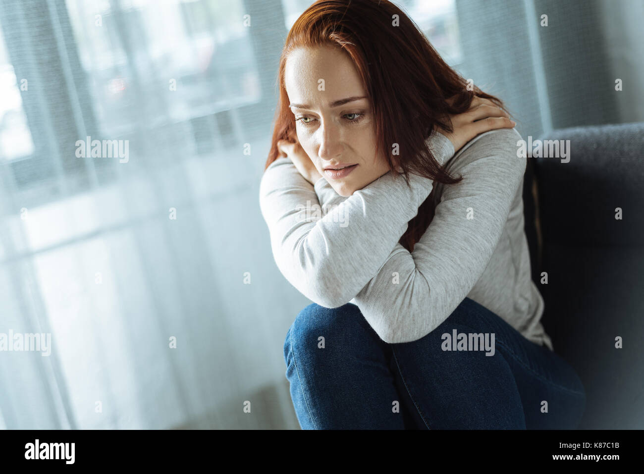 Cheerless sad woman feeling lonely - Stock Image