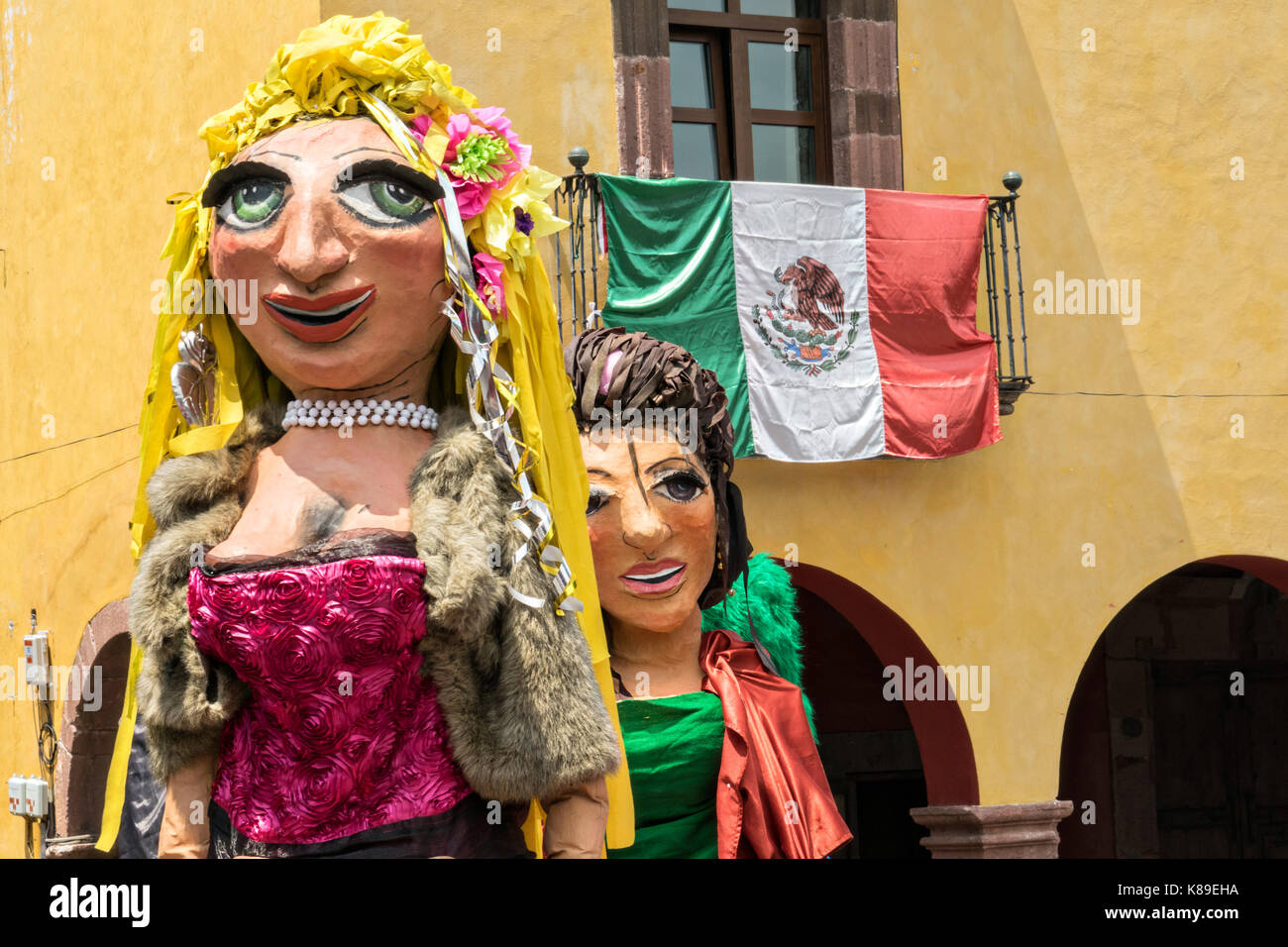 Giant papier mache puppets called mojigangas dance in the Jardin Allende during a children's parade celebrating - Stock Image