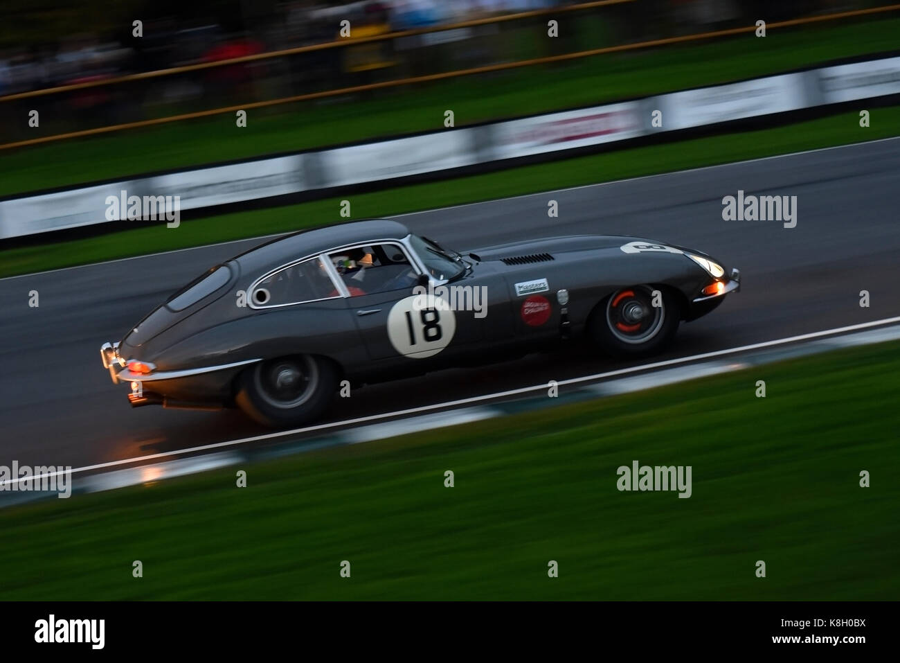 jaguar-e-type-with-glowing-red-hot-brakes-racing-in-the-kinrara-trophy-K8H0BX.jpg