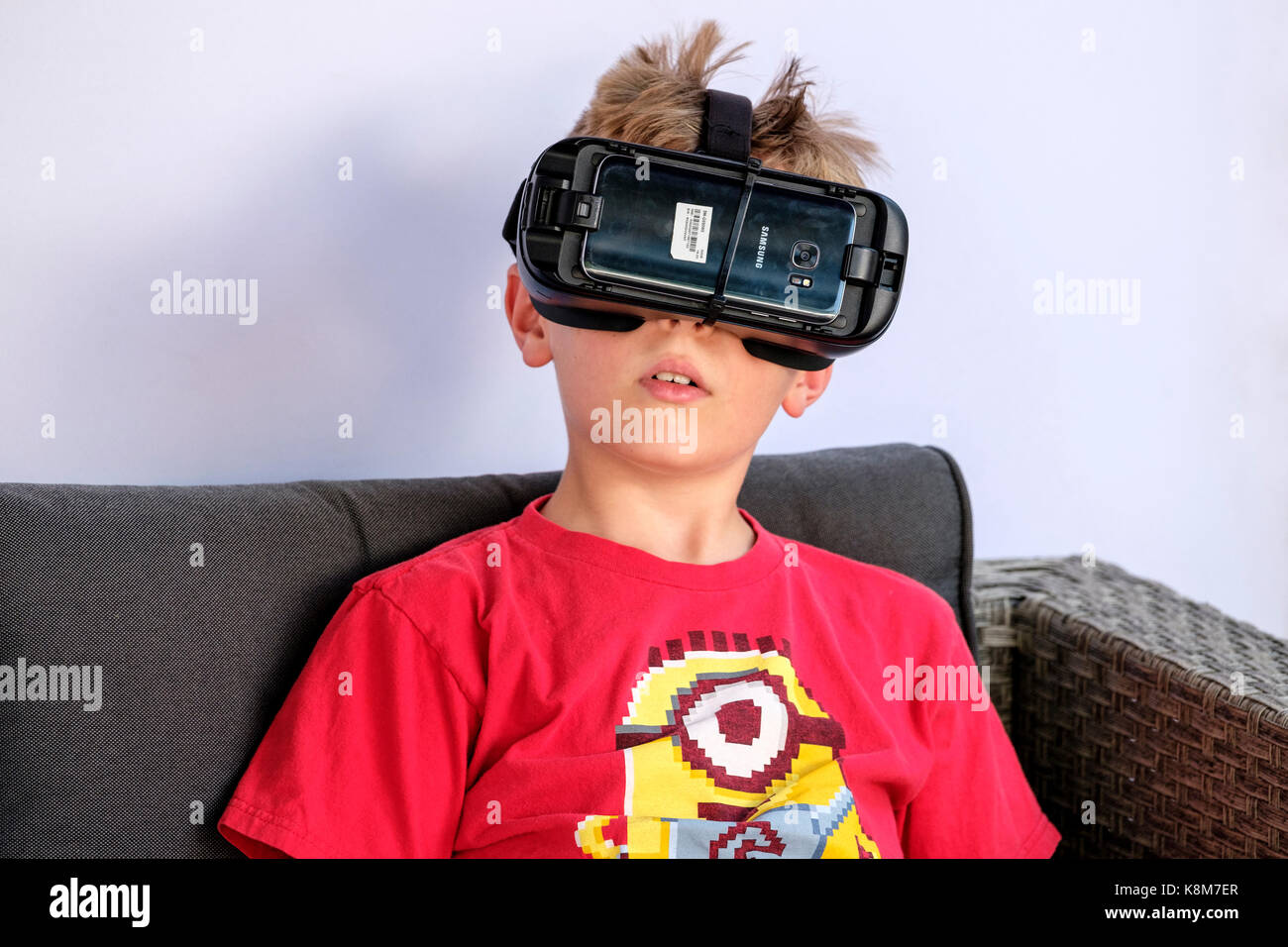 Young boy wearing Oculus Gear VR headset, virtual reality