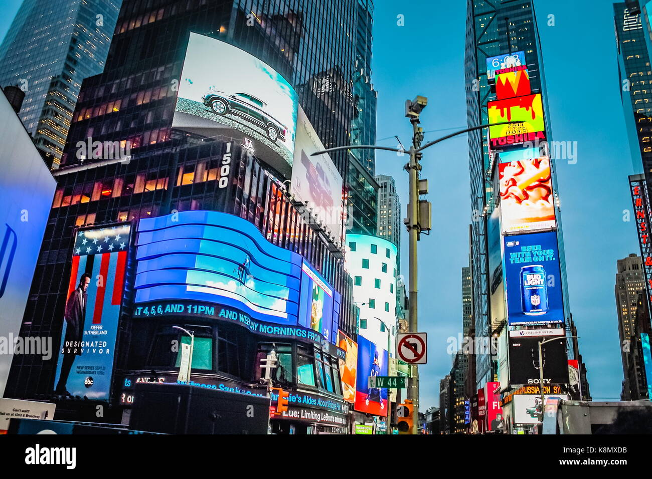 New York, USA - September 2016: Times Square advertising billboards in bright lights at West 44th Street, Manhattan. - Stock Image
