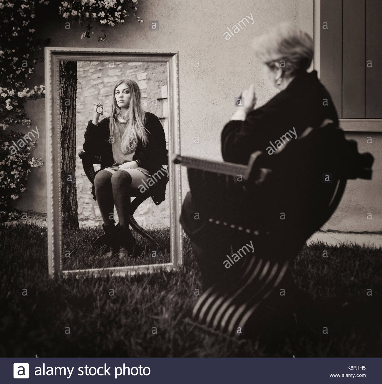 Time in the mirror: a conceptual image representing ageing and the passing of time - Stock Image