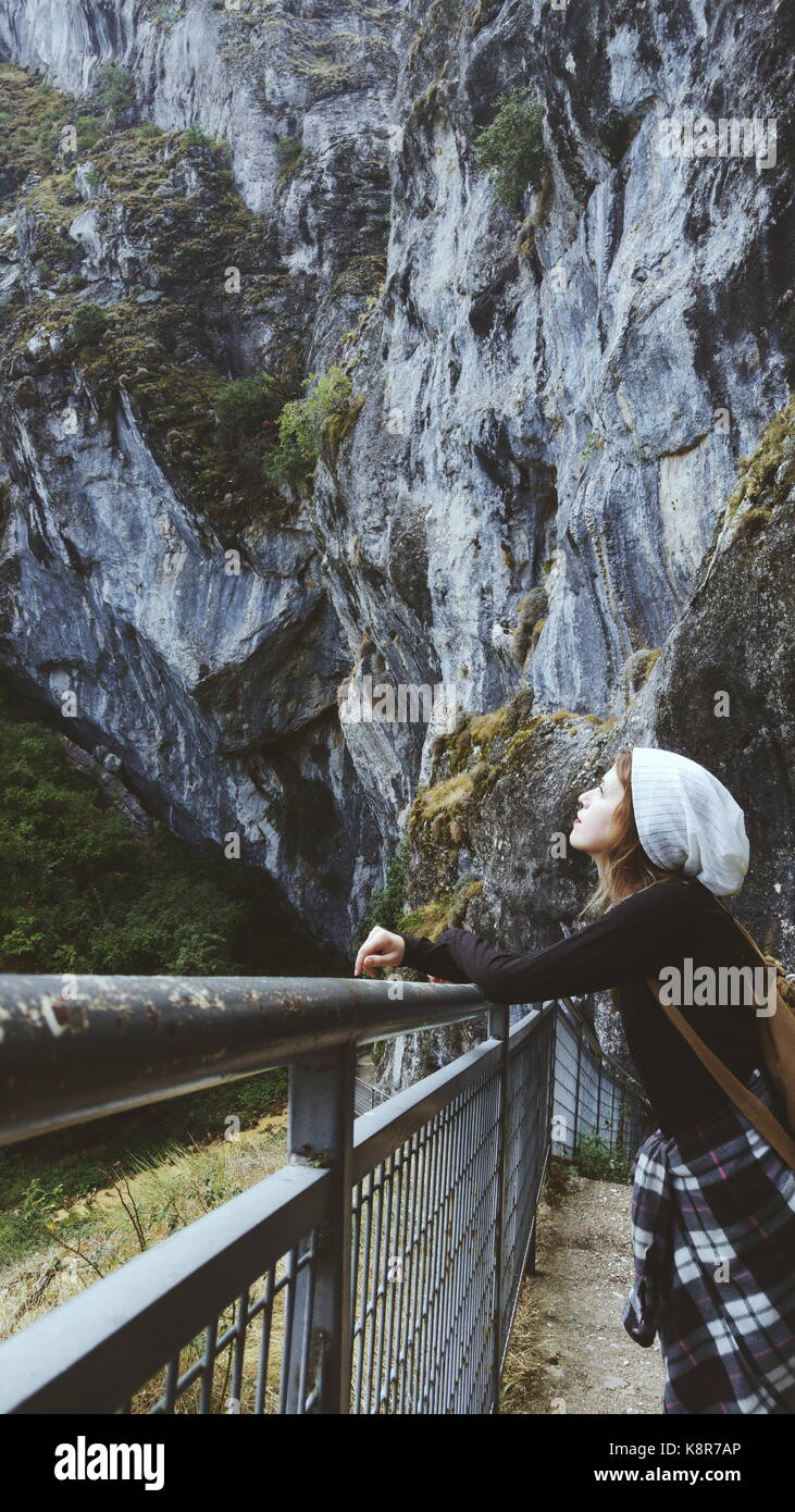 Young traveler woman lost in a huge mountain - Stock Image