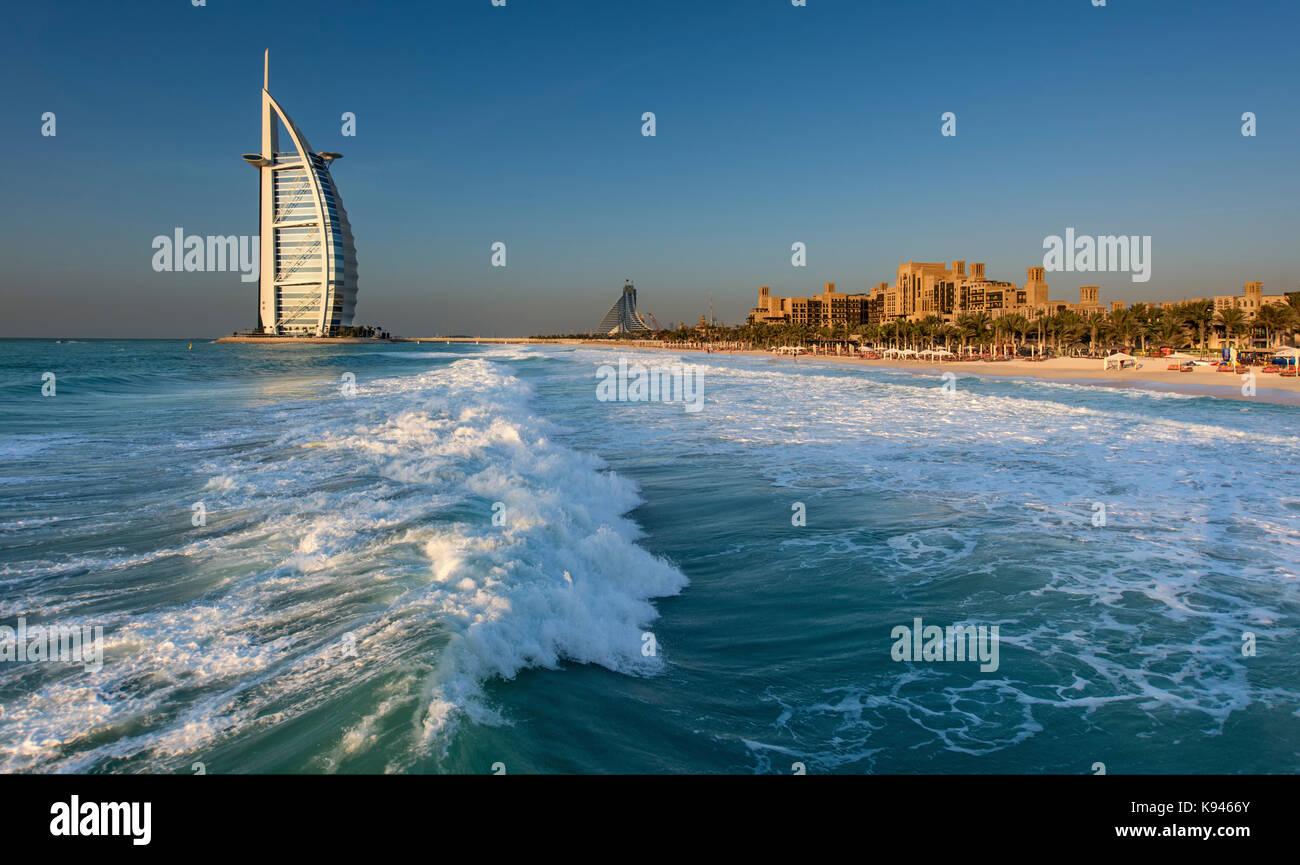 Cityscape of Dubai, United Arab Emirates, with the Burj Al Arab skyscraper on the coastline of the Persian Gulf - Stock Image