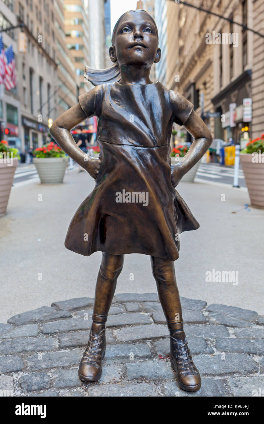 The Fearless Girl Statue on display in the Financial District, near the New York Stock Exchange in Manhattan, New - Stock Image