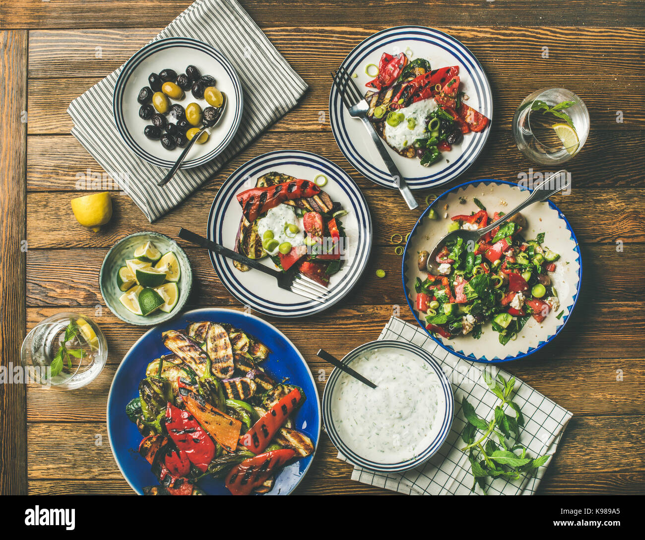 Flat-lay of healthy dinner table setting with snacks , top view - Stock Image