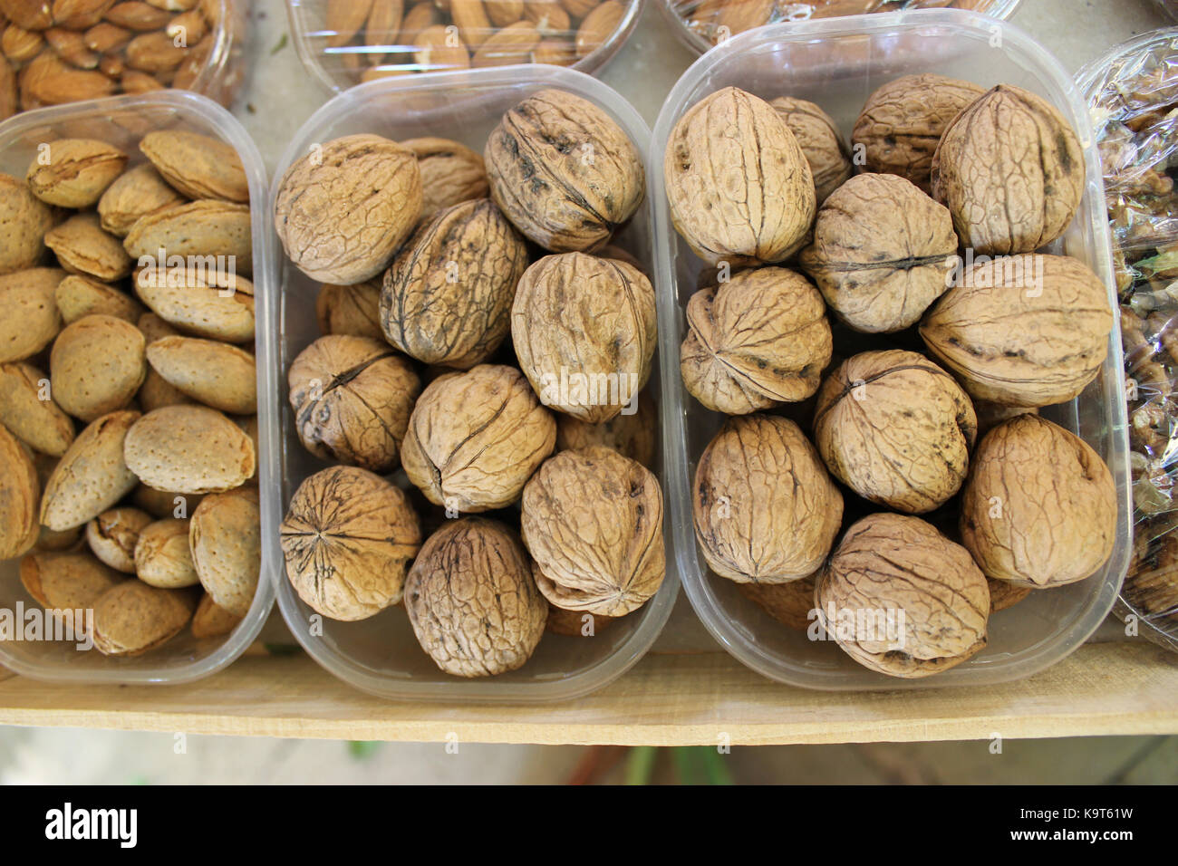Walnuts and Almonds in plastic boxes. Market in Aix-En-Provence - Stock Image
