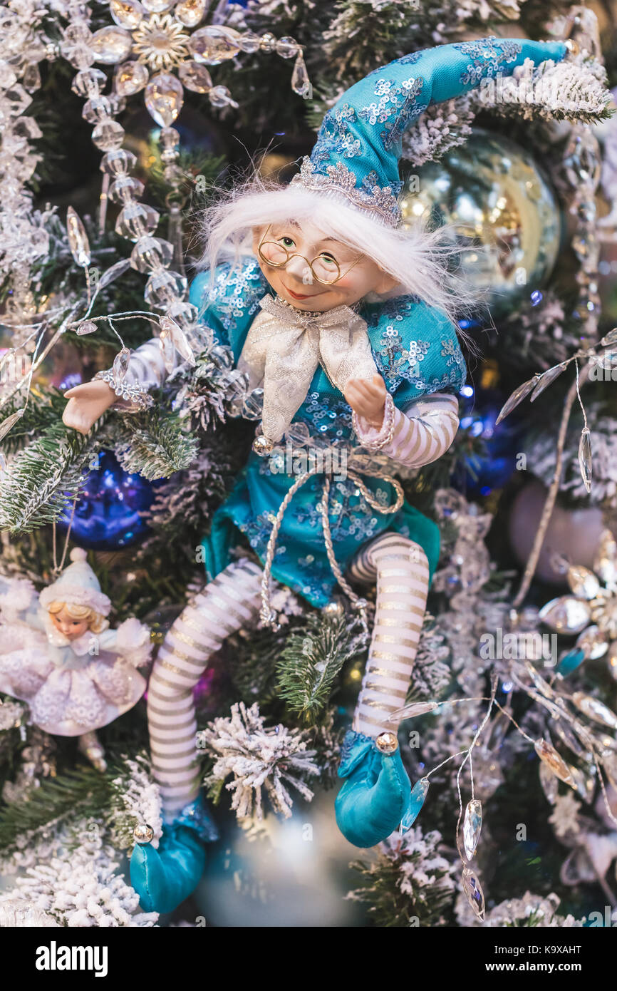 Toy figure of Santa Claus and his helpers - reindeer and elves as Christmas decorations - Stock Image