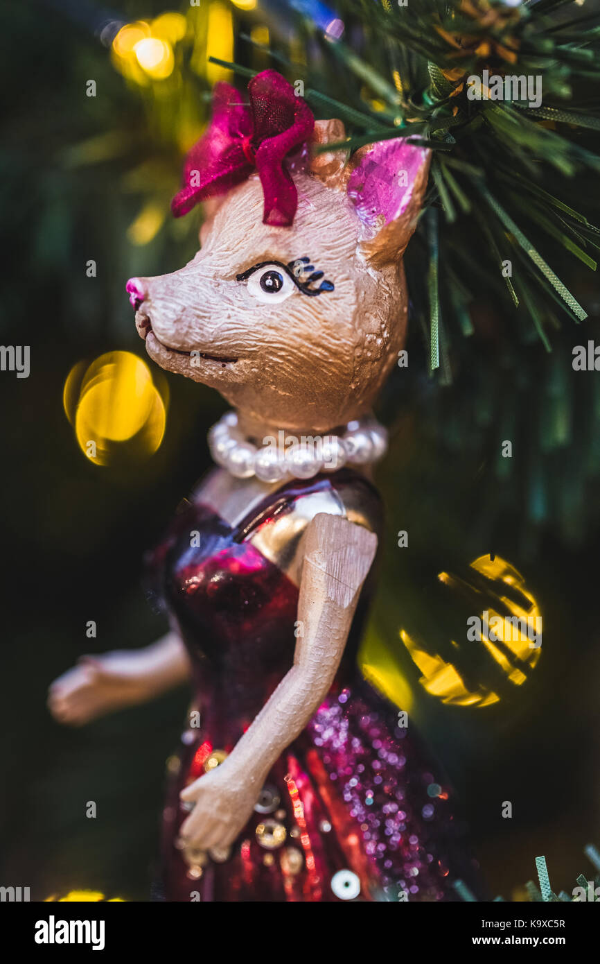 Christmas toys in form of various fashion and funny foxes - Stock Image