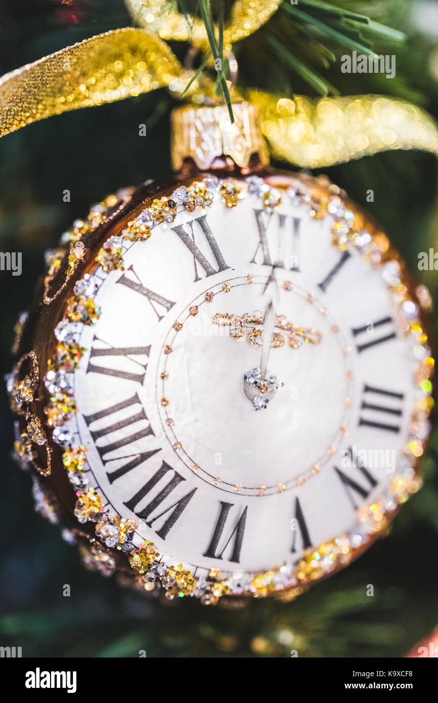 Small clock with jewelry as Christmas tree decoration - Stock Image