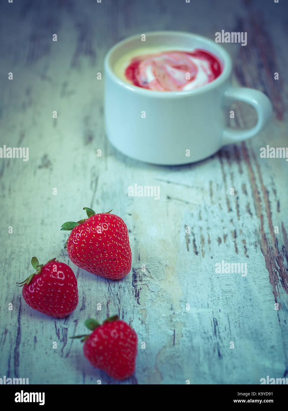 Strawberries yoghurt - Stock Image