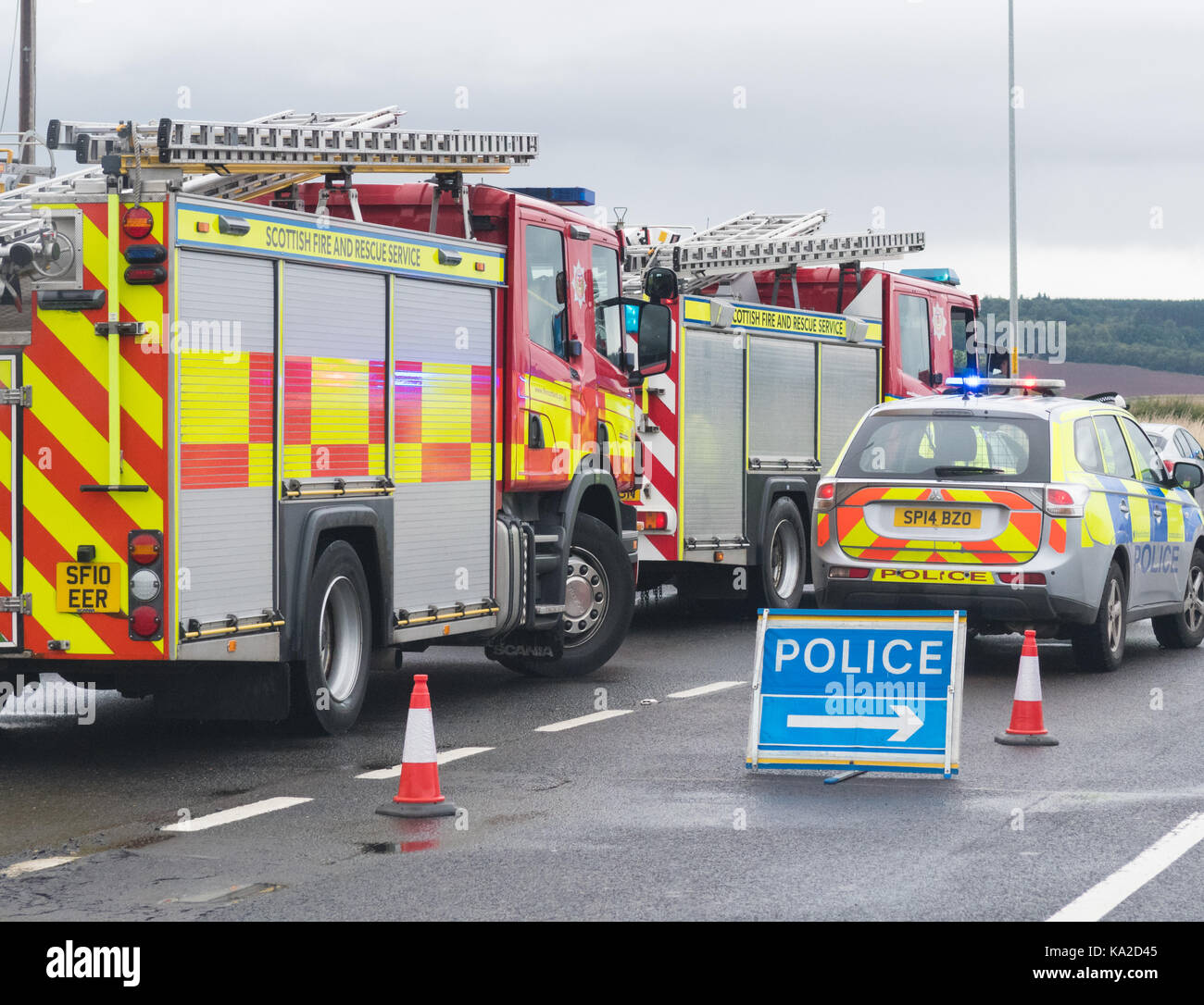 emergency services vehicles at a road traffic accident, Scotland, UK - Stock Image