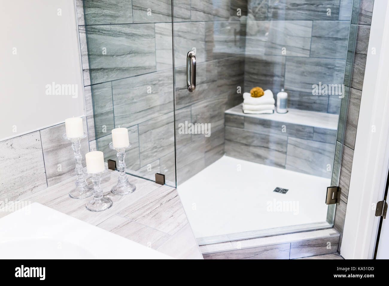 Closeup of staging modern stone grey tiled bathroom, marble Stock ...