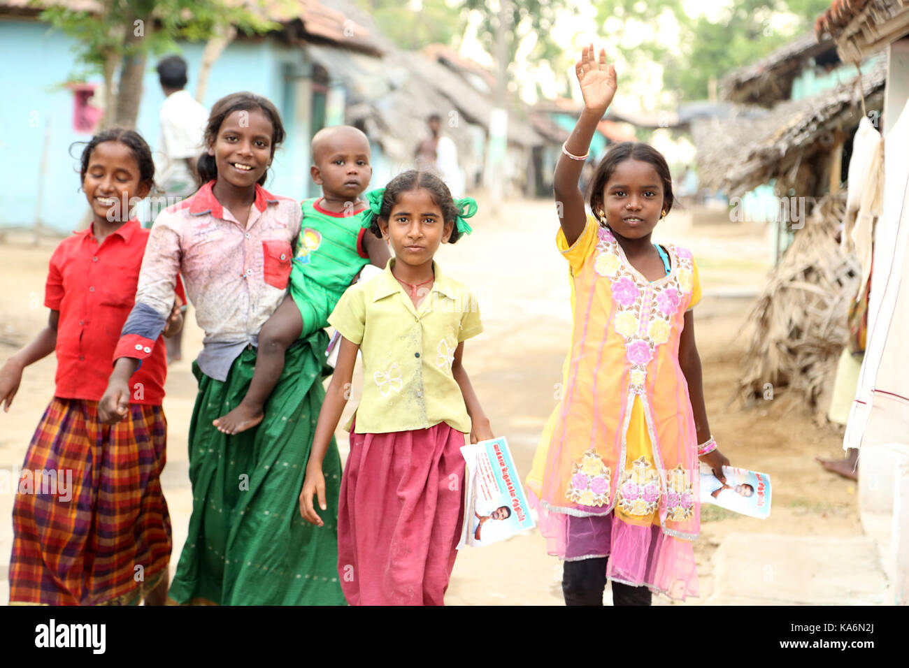 Portrait of happy kids outdoor looking at camera - Stock Image