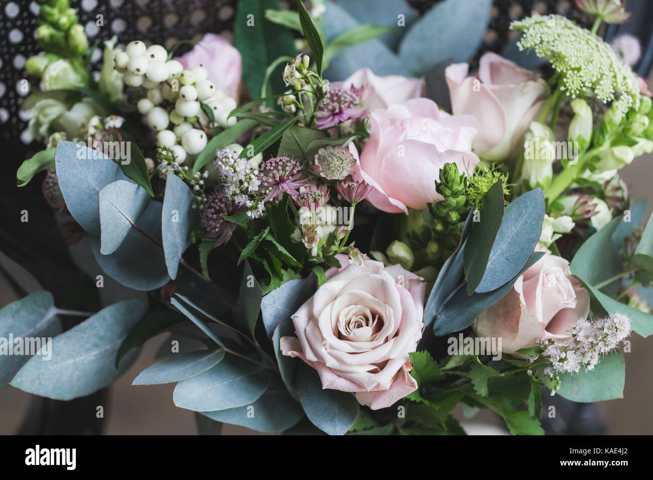Beautiful wedding bouquet with roses and peonies closeup - Stock Image