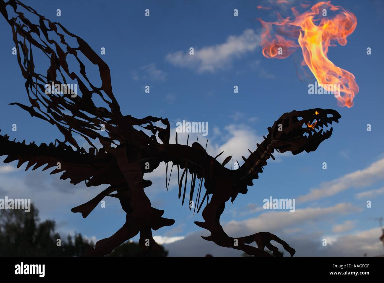 Dragon Silhouette spitting fire - Stock Image