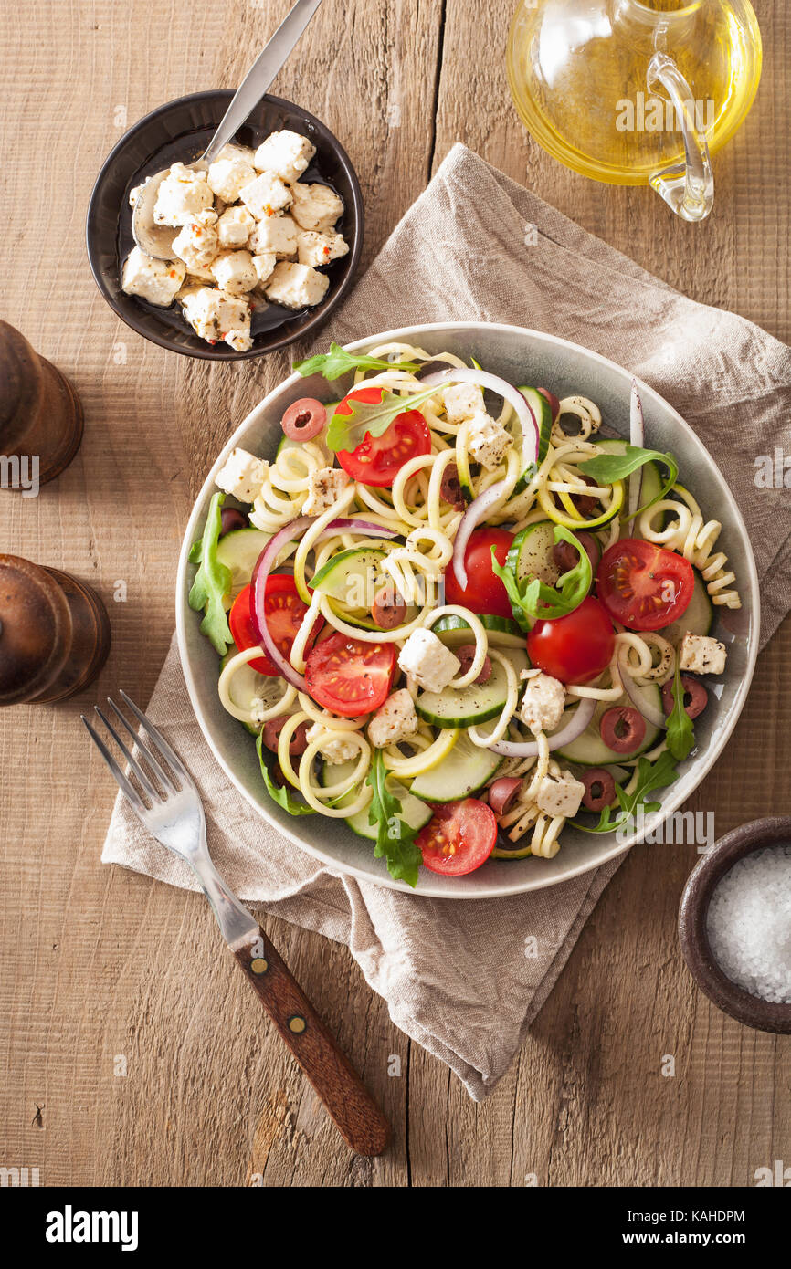spiralized courgette salad greek style with tomato feta olives cucumber - Stock Image