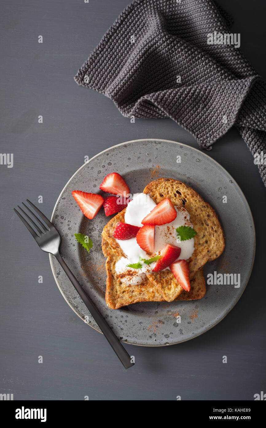 french toasts with yogurt and strawberries for breakfast - Stock Image