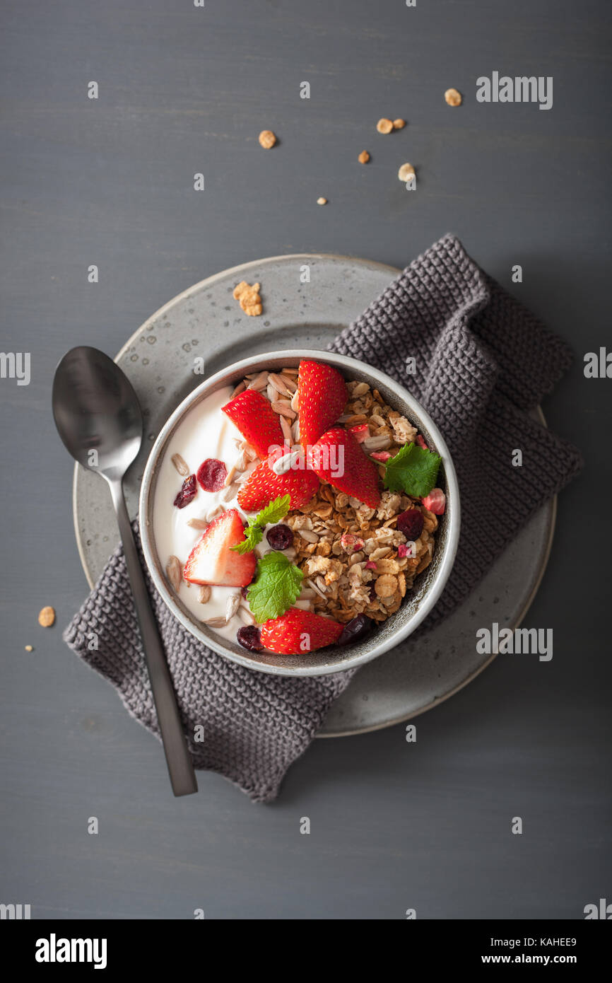 granola and yogurt with seeds and strawberry for breakfast - Stock Image