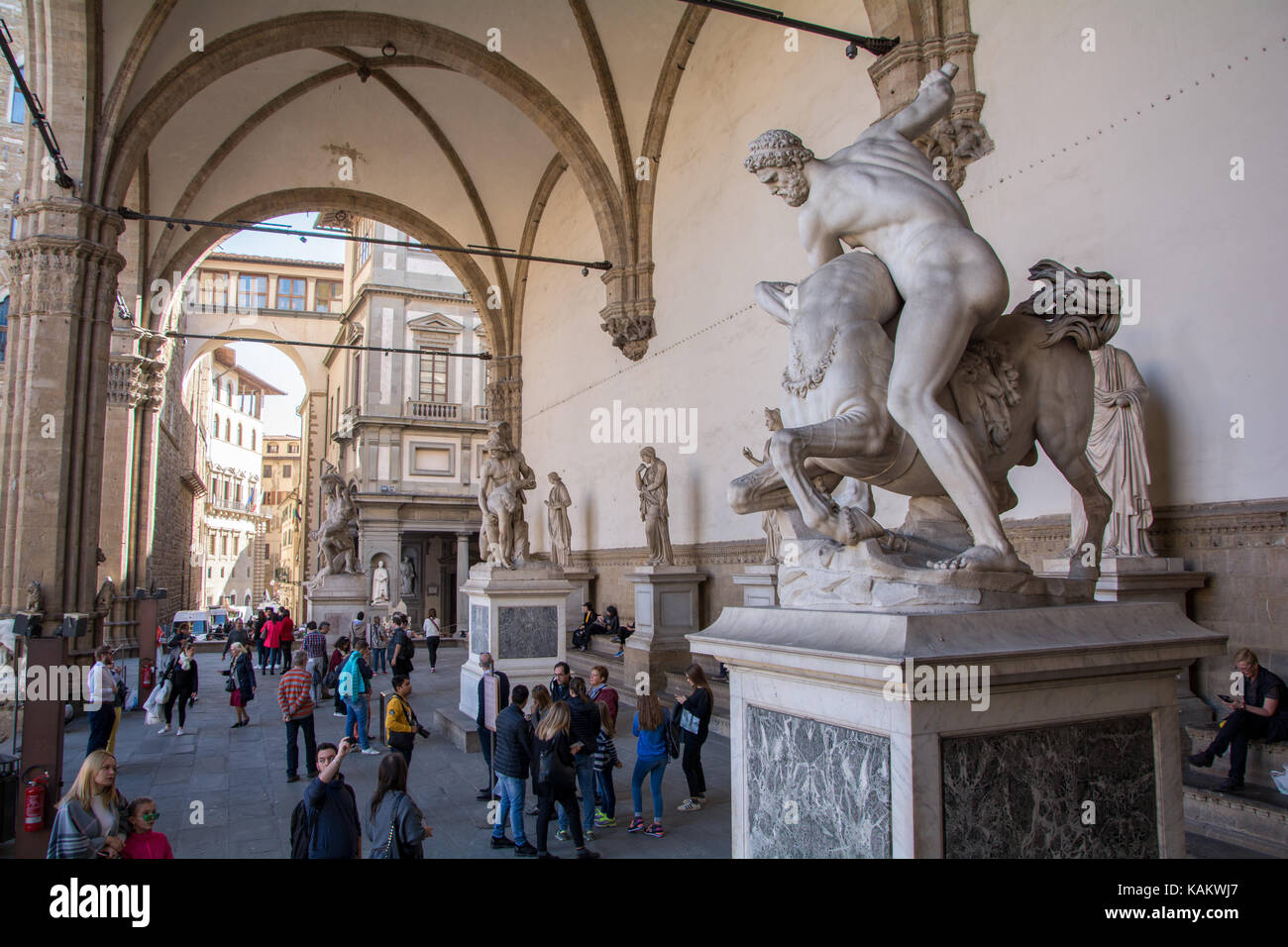 Tourists admire the various marble statues at Loggia dei Lanzi in Florence, Italy Stock Photo