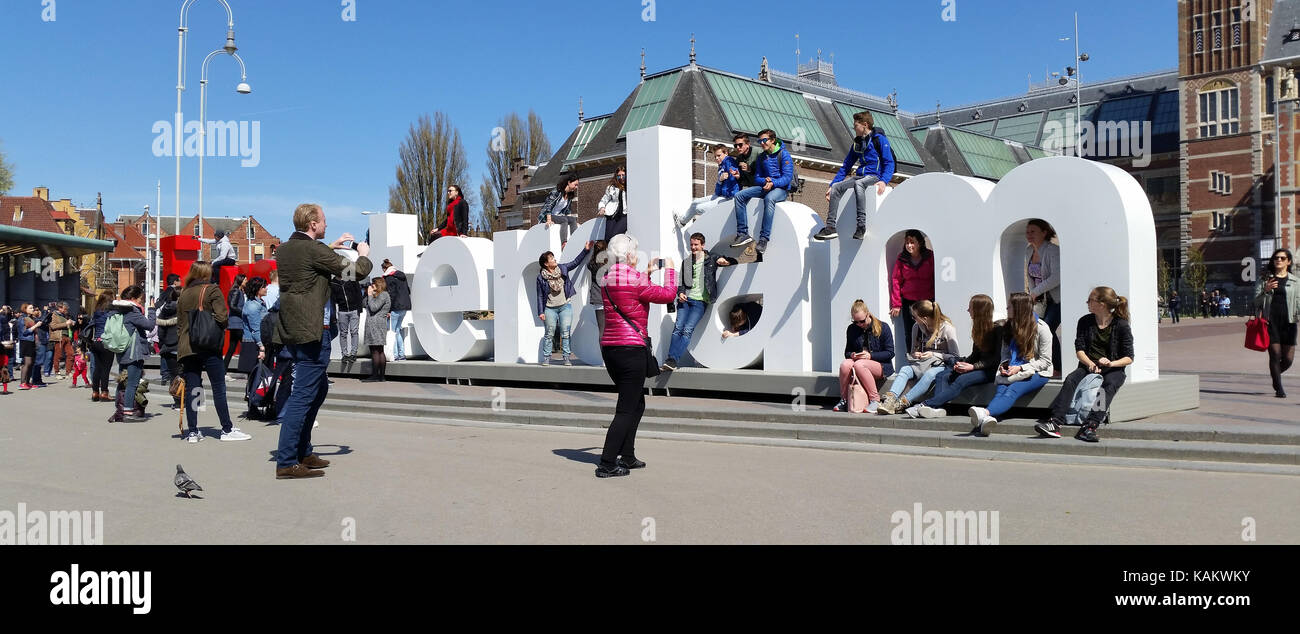 tourists-pose-in-front-of-the-i-amsterdam-sign-by-the-rijksmuseum-KAKWKY.jpg
