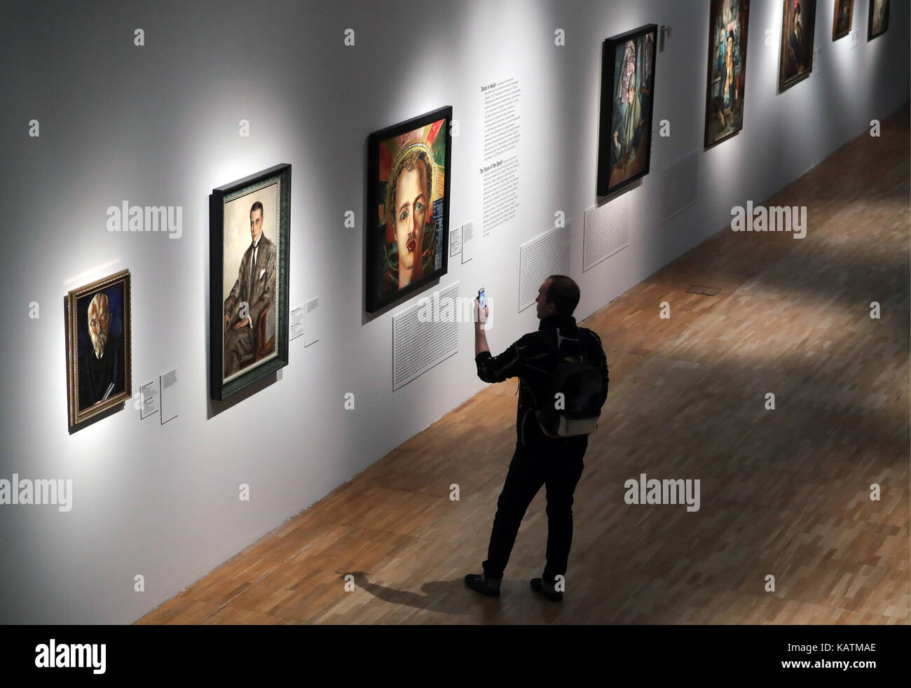 MOSCOW, RUSSIA - SEPTEMBER 27, 2017: A visitor takes a picture at the Someone 1917 exhibition at the Tretyakov Gallery. Stock Photo