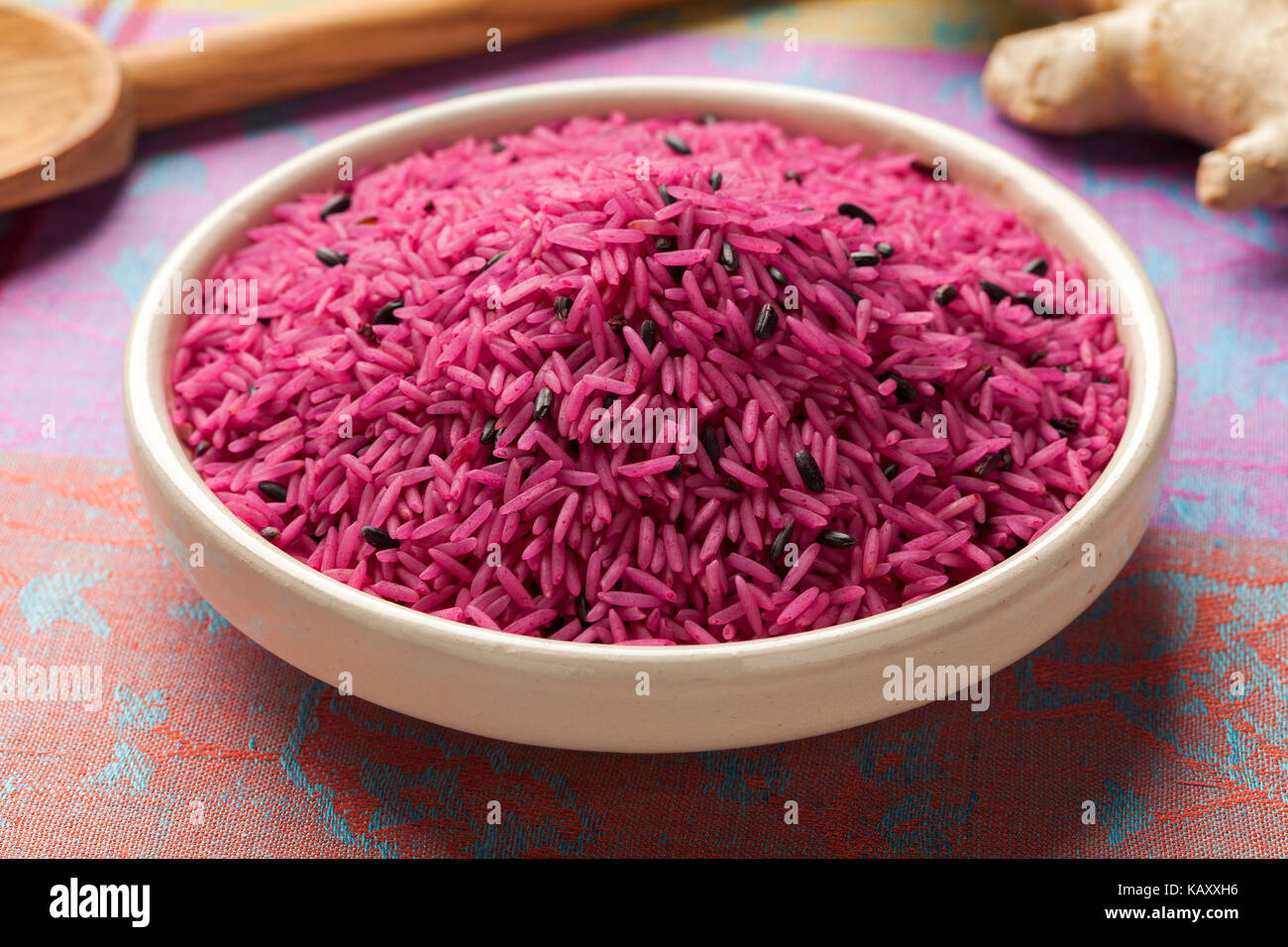 Bowl with red organic uncooked indian rice - Stock Image